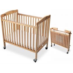 Lit bébé pliable mobile en bois coloris naturel Liméa