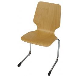 Chaise coque bois appui sur table Hortense